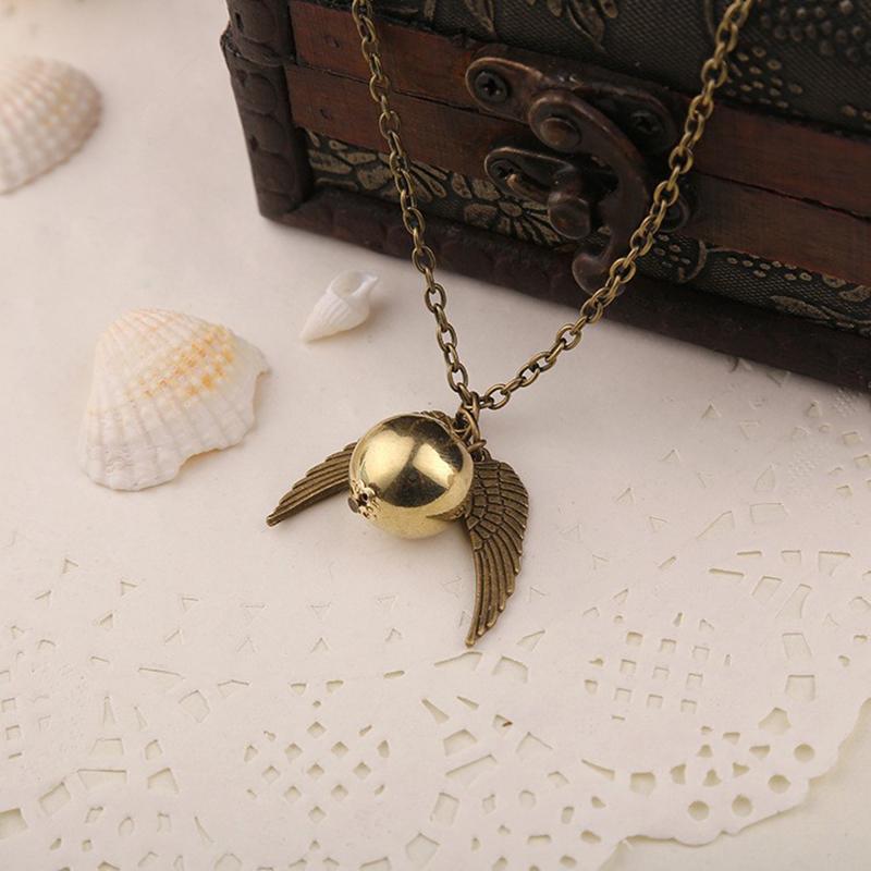 1x harry potter hogwarts fl gel goldenen schnatz h ngende. Black Bedroom Furniture Sets. Home Design Ideas
